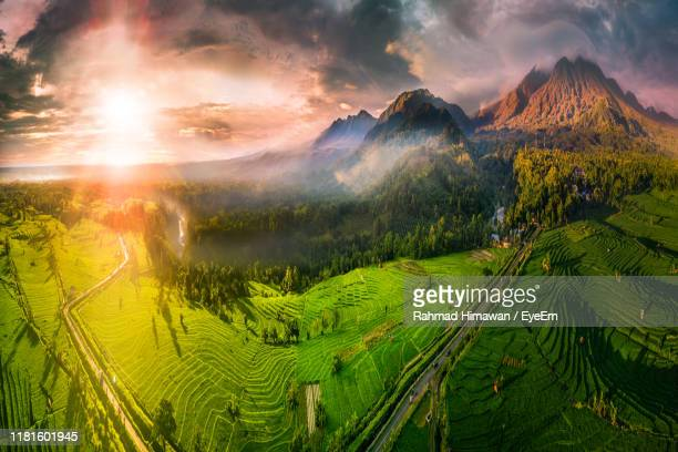 panoramic view of landscape against sky during sunset - rahmad himawan stock photos and pictures