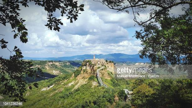 panoramic view of landscape against sky - civita di bagnoregio foto e immagini stock