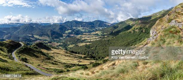 panoramic view of landscape against sky - cantal stock pictures, royalty-free photos & images