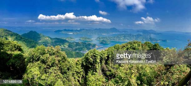 panoramic view of landscape and mountains against sky - 里山 ストックフォトと画像