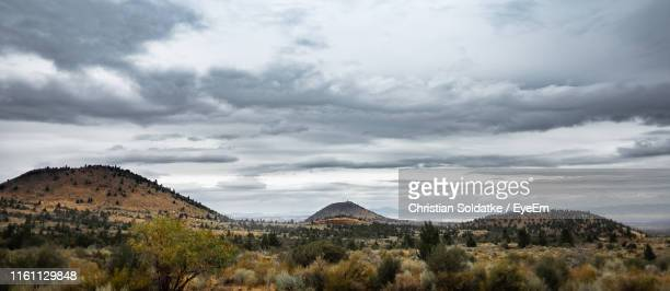panoramic view of landscape and mountains against sky - christian soldatke stock pictures, royalty-free photos & images