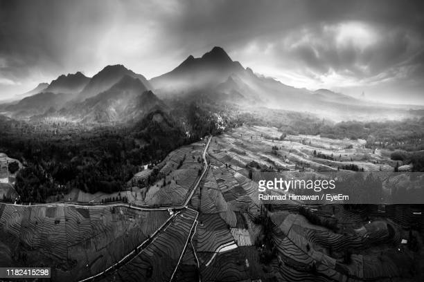 panoramic view of landscape and mountains against sky - rahmad himawan stock photos and pictures