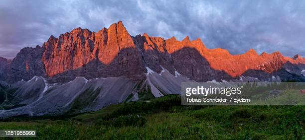 panoramic view of landscape and mountains against sky, sunrise - karwendel mountains stock pictures, royalty-free photos & images
