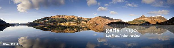 panoramic view of loch levan in flat calm conditions with perfect reflections of distant mountains including pap of glencoe, glencoe village, highland, scotland, united kingdom, europe - newpremiumuk stock pictures, royalty-free photos & images
