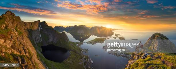 panoramic view of lofoten islands in norway with sunset scenic - seascape stock pictures, royalty-free photos & images