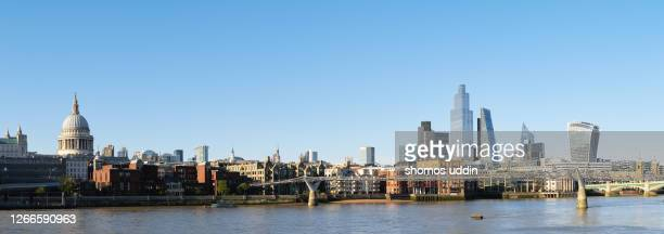 panoramic view of london city skyline across thames river - panoramic stock pictures, royalty-free photos & images