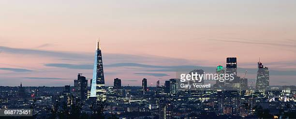 panoramic view of london skyline at dusk - yeowell stock pictures, royalty-free photos & images