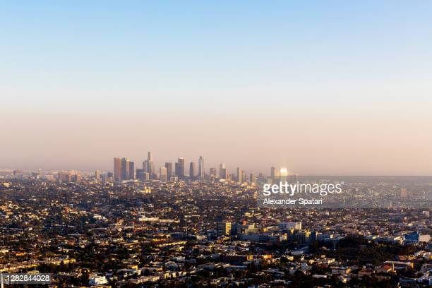 panoramic view of los angeles skyline at sunset, california, usa - los angeles stock pictures, royalty-free photos & images