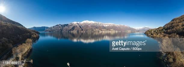 panoramic view of major lake in lombardy, italy - caputo foto e immagini stock