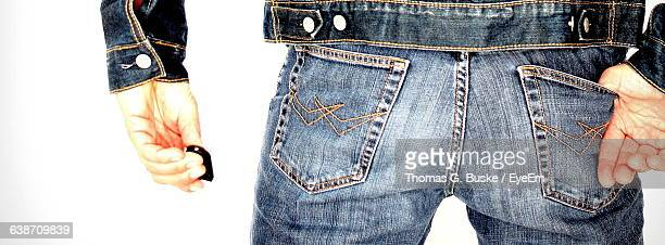 Panoramic View Of Man Wearing Jeans Against White Background