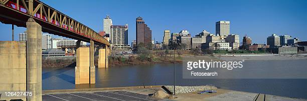 panoramic view of memphis, tn skyline from bottom of bridge over the mississippi river - memphis bridge stock photos and pictures