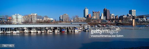 """""""panoramic view of memphis, tn skyline from mississippi river with marina in foreground"""" - memphis bridge stock photos and pictures"""