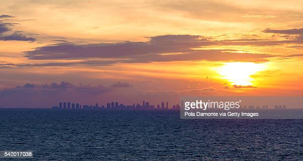 Panoramic view of Miami from the caribbean sea at sunset