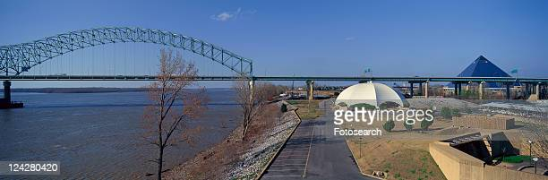 panoramic view of mississippi river with bridge - memphis bridge stock photos and pictures
