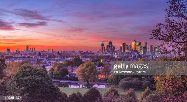 panoramic view of modern buildings against sky during sunset - greenwich london stock pictures, royalty-free photos & images