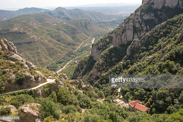 panoramic view of monserrat monastery and cable car (aeri de montserrat) - abby road stock photos and pictures
