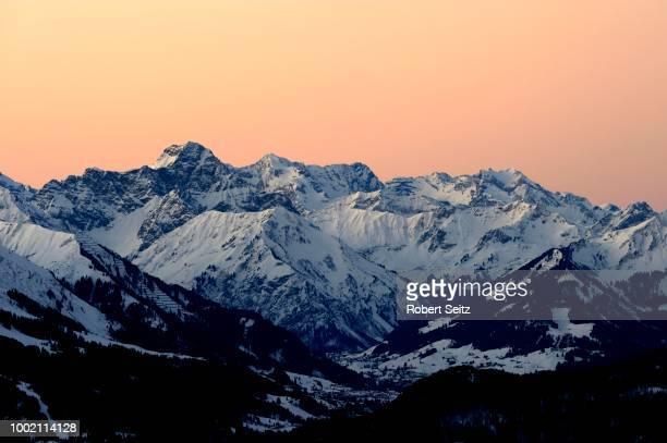 Panoramic view of mountain peaks, at sunset, Allgaeu Alps, Tyrol, Austria