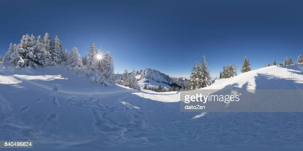 360° panoramic view of mountain winter landscape with deep snow and snow packed trees, Kampenwand mountain area, Upper Bavaria, Germany