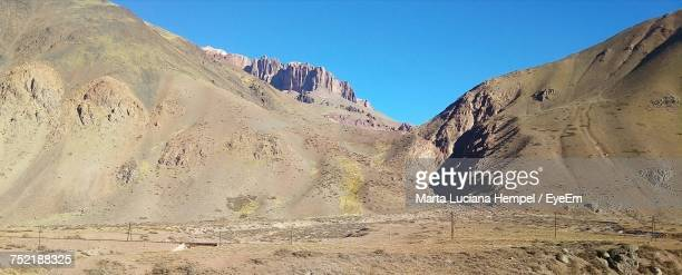 Panoramic View Of Mountains Against Clear Blue Sky