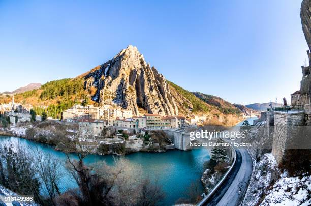 panoramic view of mountains against clear blue sky - sisteron stock pictures, royalty-free photos & images