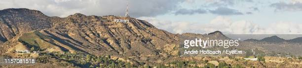 panoramic view of mountains against cloudy sky - hollywood california stock pictures, royalty-free photos & images