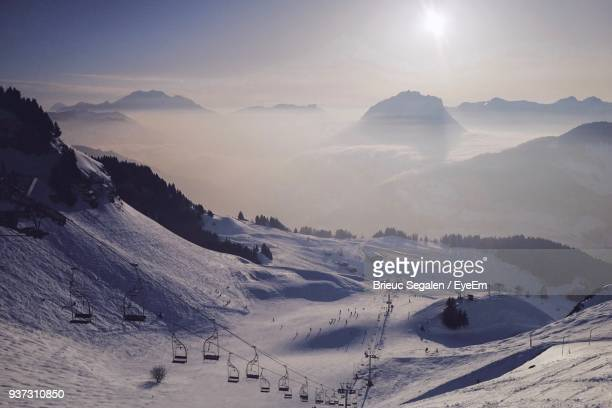 panoramic view of mountains against sky during winter - le grand bornand stock pictures, royalty-free photos & images