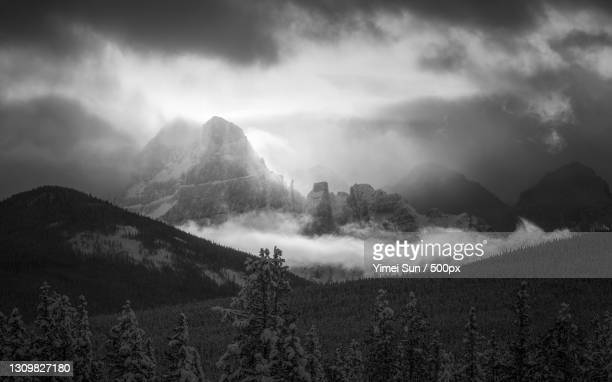 panoramic view of mountains against sky,banff,alberta,canada - canada stock pictures, royalty-free photos & images