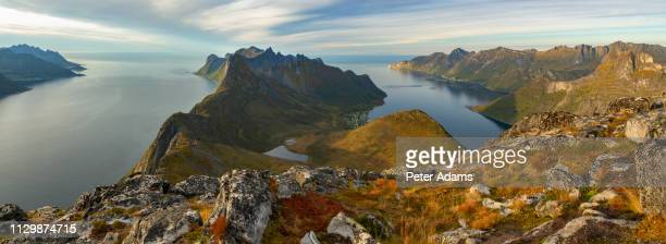 panoramic view of mountains and fjord, senja island, norway - peter adams stock pictures, royalty-free photos & images
