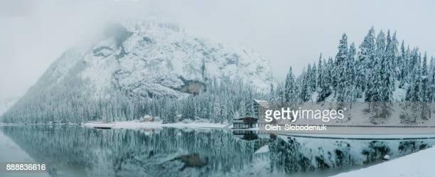 panoramic view of mountains  in winter - dolomiti foto e immagini stock