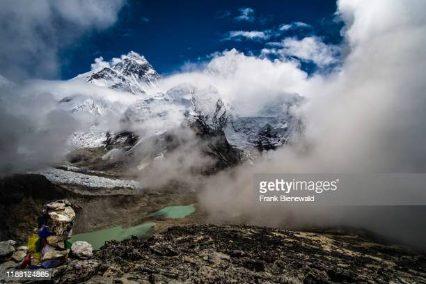 Panoramic view of Mt. Everest and Khumbu glacier from the top of Kala Patthar, monsoon clouds rising up.