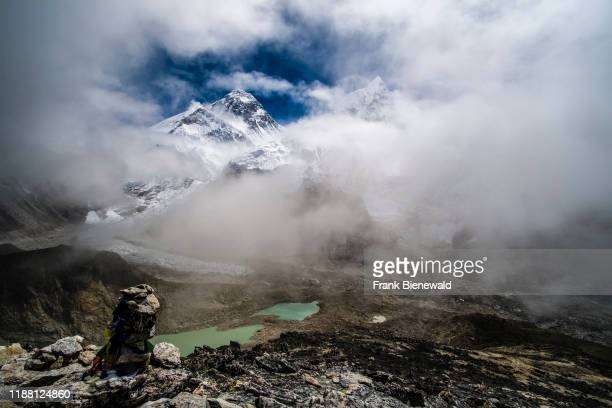 Panoramic view of Mt. Everest, Mt. Nuptse and Khumbu glacier from the top of Kala Patthar, monsoon clouds rising up.
