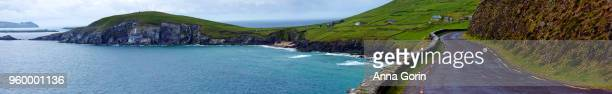 Panoramic view of narrow road leading to Slea Head on Dingle Peninsula, stormy spring day in western Ireland