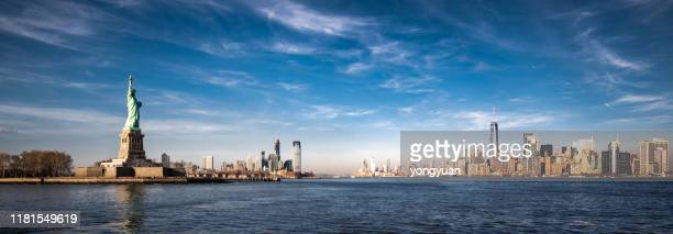 panoramic view of new york city and the statue of liberty - statue of liberty stock pictures, royalty-free photos & images