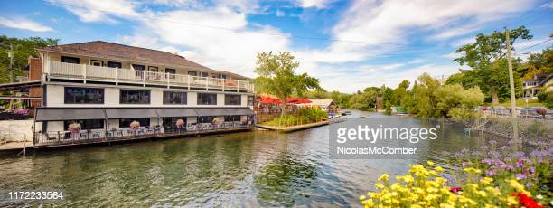 panoramic view of north hatley's massawippi river shore with restaurant - eastern townships stock pictures, royalty-free photos & images