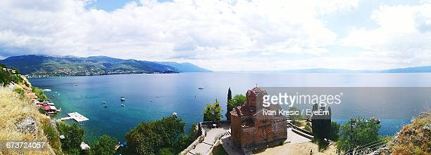 panoramic view of ohrid lake against sky - lake ohrid stock photos and pictures