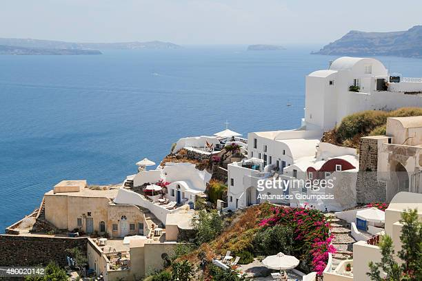 Panoramic view of Oia town on June 30 2015 in Santorini Greece Oia typifies the white painted houses of the Cyclades built directly into niches which...
