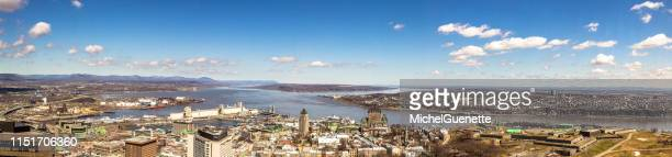 panoramic view of old quebec city from the air. plaines d'abraham, chateau frontenac, st-lawrence river, levis and ile d'orleans - lévis quebec stock pictures, royalty-free photos & images