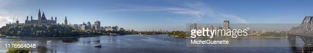 panoramic view of ottawa, parliament hill, gatineau,   victoria bridge and outaouais river. - gatineau stock pictures, royalty-free photos & images