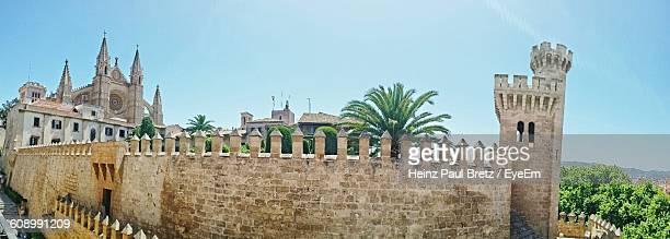 panoramic view of palma cathedral against sky - palma majorca stock photos and pictures