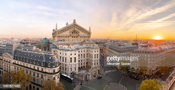 panoramic view of paris skyline with garnier opera and eiffel tower during sunset, paris, france - music style stock pictures, royalty-free photos & images
