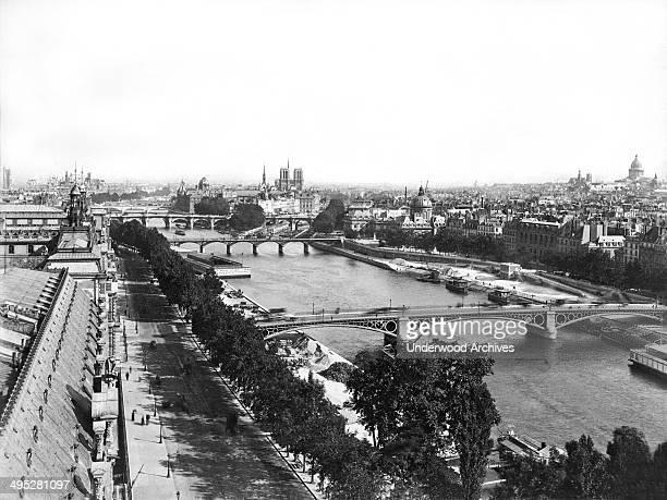 A panoramic view of Paris upstream from the Royal Bridge across the River Seine Paris France circa 1890