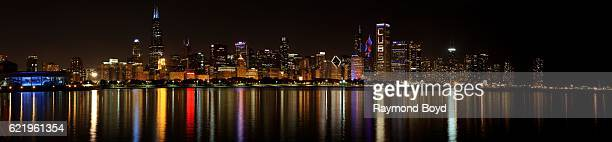Panoramic view of parts of the Chicago Skyline lighting up blue and red to celebrate the Chicago Cubs' world series win against the Cleveland Indians...