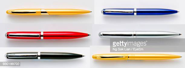 Panoramic View Of Pens Over White Background