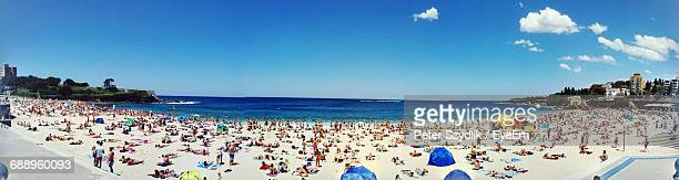 Panoramic View Of People At Coogee Beach Against Sky