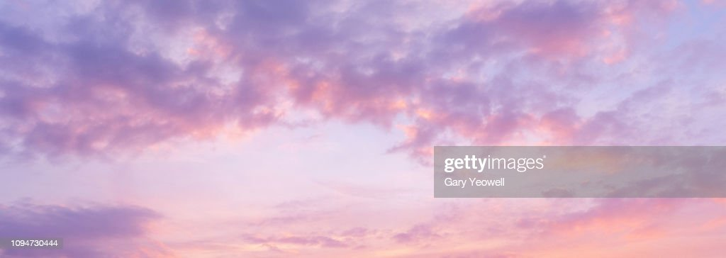 Panoramic view of pink clouds in sky at sunset : Stock Photo