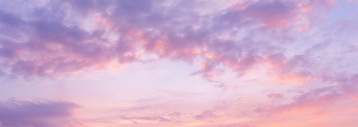 Panoramic view of pink clouds in sky at sunset - gettyimageskorea