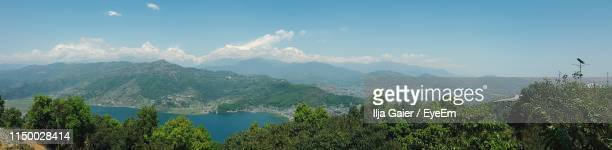 panoramic view of plants and mountains against sky - pokhara stock pictures, royalty-free photos & images