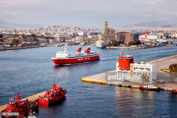 panoramic view of port of piraeus with ferry boats, tugboats and the pilot's station at harbor. - piraeus stock photos and pictures