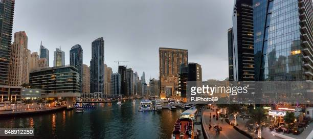 panoramic view of promenade of dubai marina at evening - pjphoto69 stock pictures, royalty-free photos & images