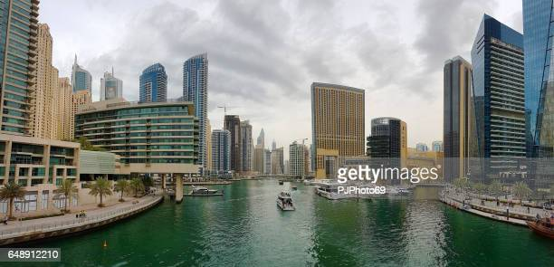panoramic view of promenade of dubai marina - pjphoto69 stock pictures, royalty-free photos & images
